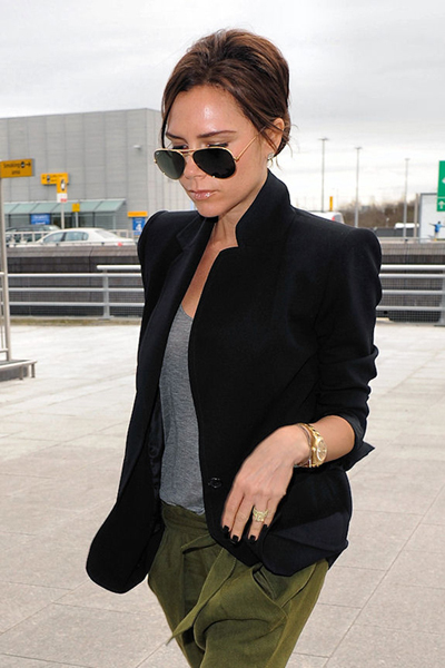 Victoria Beckham looking fashionably charming in a pair of olive green silk